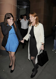 Sarah Ferguson was spotted in her usual classic look, wearing an LBD teamed with a cream-colored trench.