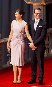 Princess Victoria exuded charm and elegance in a lavender dress adorned with lovely appliques.