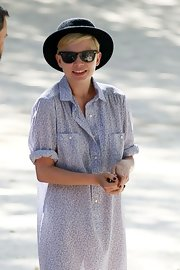 Michelle Williams mixed feminine-and-masculine style by pairing this bowler with her girlish dress.