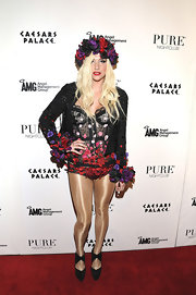 Kesha stuck to her signature dramatic style with this floral bustier top and matching head piece and blazer.