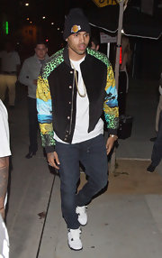 Chris Brown stayed comfortable in a pair of pristine white sneakers as he headed out for a night of partying.