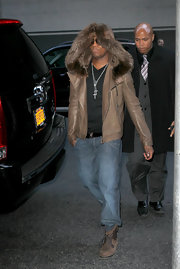 Ne-Yo stood out in NYC in a brown leather jacket with a fur-lined hood.