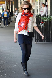Rachael brightened her nautical-inspired look with a colorfully printed silk scarf.