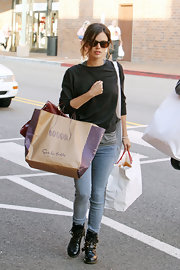 Rachel Bilson toughened up her casual wear with black buckled ankle boots.