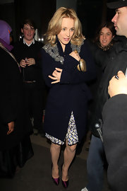 Rachel bundled up in a navy evening coat with beaded shoulders.