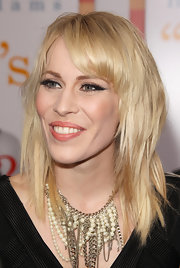 Natasha completed her look with a chain and pearl embellished statement neckalce.