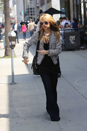 Rachel Zoe chose this Chanel-inspired fitted jacket to dress up her hippie-look while out in Beverly Hills.