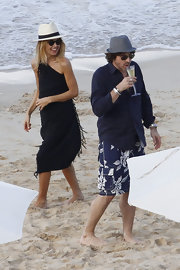 Rachel Zoe splashed in the surf in a black fringed sarong.