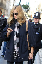 Fearne wears a casual plaid scarf with her winter ensemble for her outing in London.