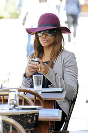 Eve polished off her look with a purple suede dress hat while dining in New York.
