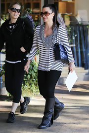 Kyle Richards added a nautical touch to her street style with a striped cowl neck top.