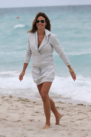 Kelly Bensimon opted for a more dressed-up sweatshirt for her beach-time look.