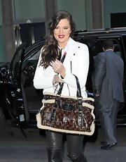 Khloe Kardashian toted a shearling-lined Louis Vuitton bag.