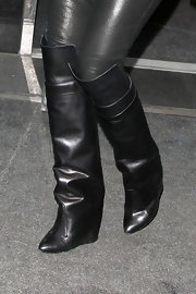 Khloe stepped out in a pair of black leather knee-high wedge boots.