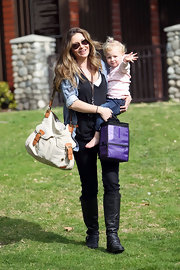 Rebecca Gayheart took her daughter to the park with a stylish canvas and leather bag slung over her shoulder.