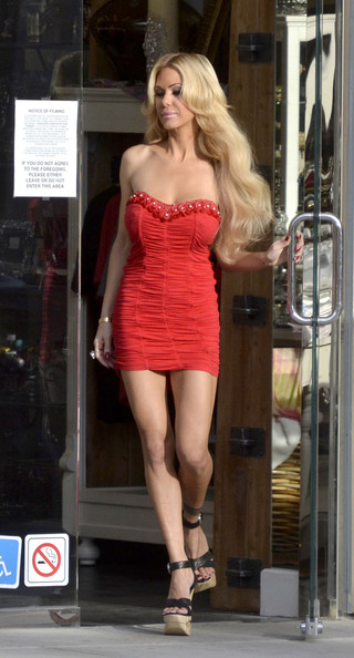 Shauna Sand turned heads in a pair of ultra-high platform sandals and a red strapless mini dress while shooting in Beverly Hills.