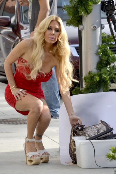 Shauna Sand wore a precarious-looking pair of white platform sandals during a shoot in Beverly Hills.