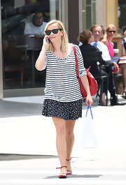 Reese Witherspoon mixed patterns when she paired this delicate floral-print mini skirt with a striped top.