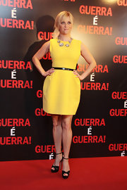 Reese topped off her sunny yellow cocktail dress with platform sandals.