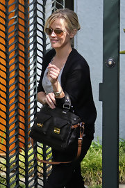 Another day around Brentwood and Reese is seen out with a cute black leather bag. Reese's style is casual, but she always manages to add a nice flare.
