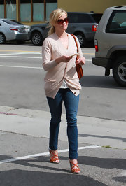 Reese Witherspoon made her way through LA in a pair of orange Proenza Schouler braided crisscross wedges.