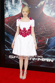Emma Stone looked regal at the 'Amazing Spider-Man' premiere wearing this white square-neck dress with thick red embroidery.