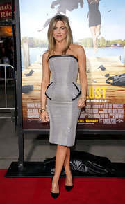 Jennifer Aniston wore this peplum herringbone dress to the 'Wanderlust' premiere.