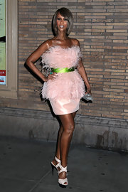 This bright green satin belt adds even more flair to Iman's Jason Wu feathered dress.
