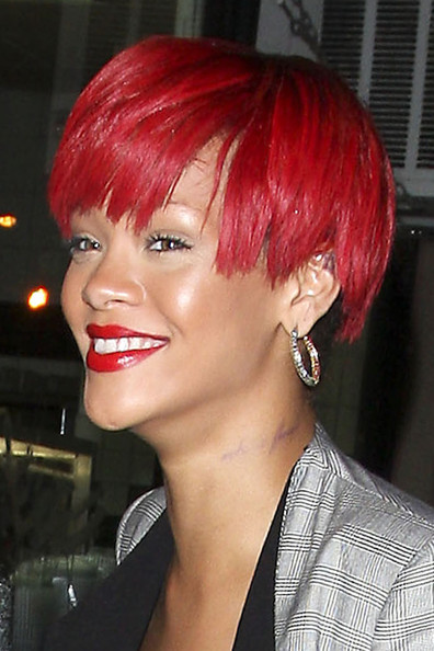 Rihanna Lettering Tattoo [tattoo,hair,human hair color,hairstyle,eyebrow,chin,lip,red hair,hair coloring,asymmetric cut,black hair,bag,rihanna,neck,beau,side,inscription,hotel,salon,restaurant,rihanna,tattoo,body art,rebl fleur,celebrity,rebelle,image,loud,tattoo ink,photograph]