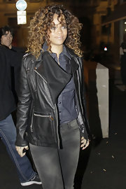 Rihanna was spotted at the Armani Boutique after party in Milan wearing a leather jacket over a chambray button-down shirt.