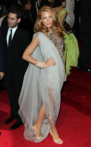 Blake Lively accented her draped Chanel gown with delicate nude Anna sandals.