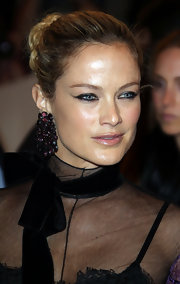 Carolyn Murphy wowed on the red carpet of the Met Gala with purple gemstone earrings.