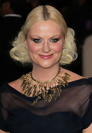 Amy Poehler added some interest to her neckline with a gold leaf statement necklace.