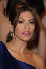 Eva Mendes offset her one-shoulder dress with 1960's gold and diamond triple hoop earrings.