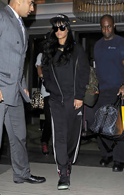 Rihanna's long wavy locks made even her gym clothes look gorgeous.
