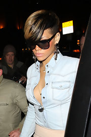 Rihanna showed off her decorative side in a pair of cross pendant earrings.