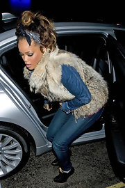 Rihanna wore a knotted head scarf as a head band while out in London.