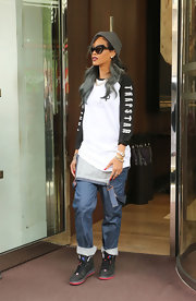 Rihanna paired a black and white baseball tee with a pair of folded over overalls while out and about in London.