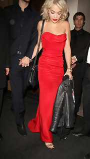 Rita stunned in a fitted strapless dress while out in London.