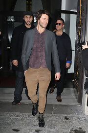 Howard Donald paired his chinos with a plaid shirt, blazer, and boots for a youthful eclectic look.
