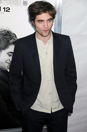 Robert kept his look polished with a black blazer.