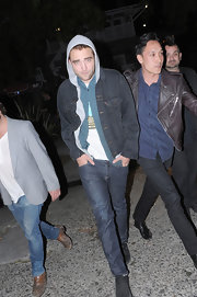 Robert Pattinson stepped out sported a dark-wash denim jacket over a hoodie for a casual and cool look while out with friends.