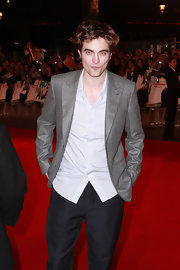 Robert cleans up nicely in a shimmering gray blazer.