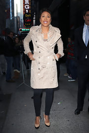 Robin Roberts' beige trenchcoat was made ultra-girly by its lace fabric.