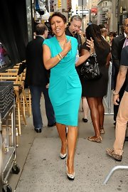 Robin Roberts finished off her chic ensemble with a pair of snakeskin platform pumps.