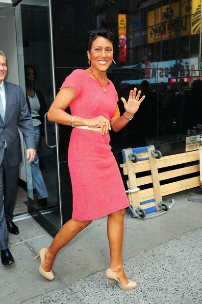 Robin Roberts paired nude pumps with her pink dress for a classic look.