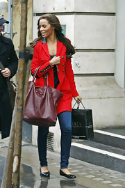 Rochelle Wiseman brightened her rainy day style with a crimson military-style coat with leather trim.