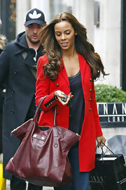 Rochelle Wiseman didn't travel light in London, toting shopping bags and a deep red leather tote.