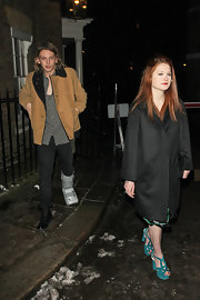 Jamie Campbell Bower battled the cold in style with a tan pea coat.