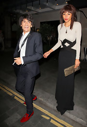 Ana Araujo went for simple elegance with a long-sleeve two-tone evening dress for a dinner out with Ronnie Wood.